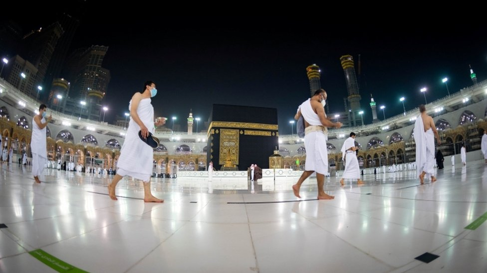 Muslims keep a safe social distance while performing Umrah at the Grand Mosque on 3 October 2020