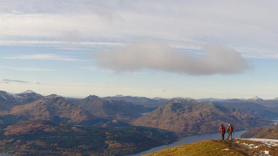 A couple pause for a rest on Ben Lomond