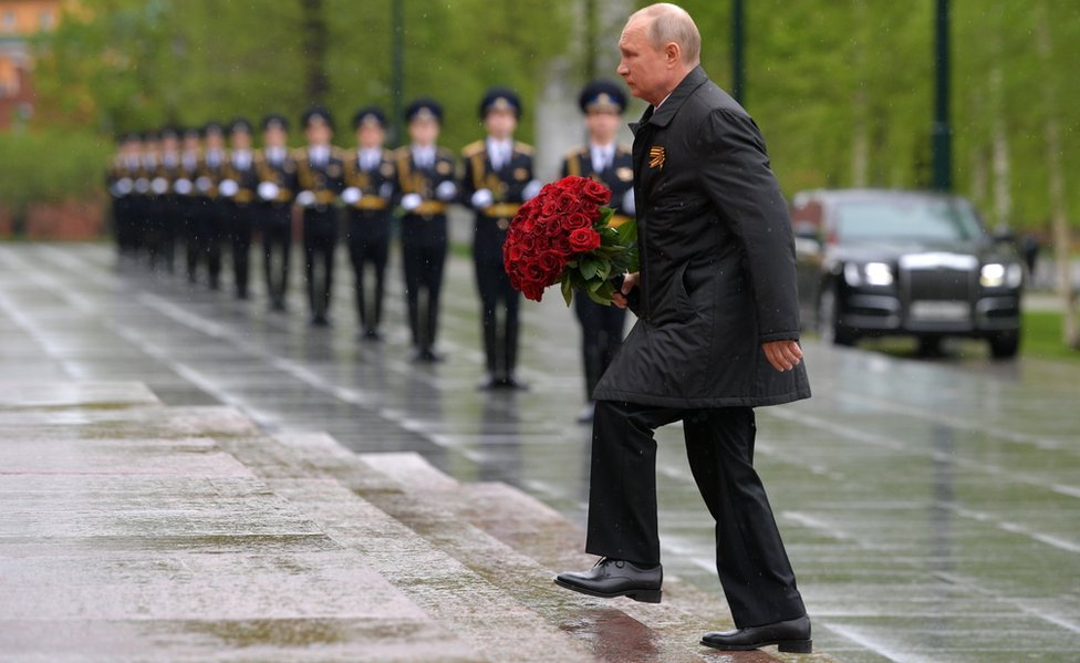 Russia's President Vladimir Putin lays flowers at the Tomb of the Unknown Soldier