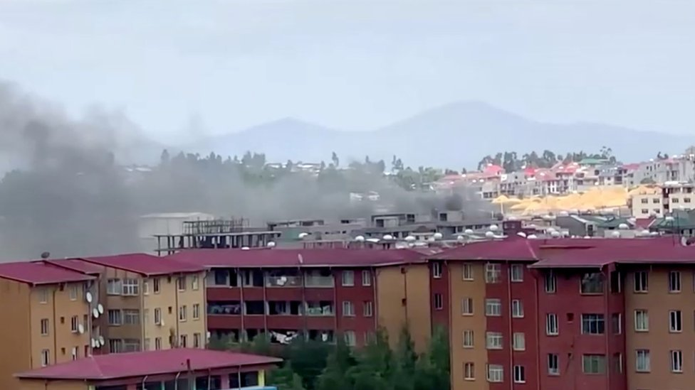 Smoke rises over Addis Ababa skyline during protests following the fatal shooting of the Ethiopian musician Hachalu Hundessa, in Addis Ababa, Ethiopia June 30, 2020, in this screengrab taken from a video