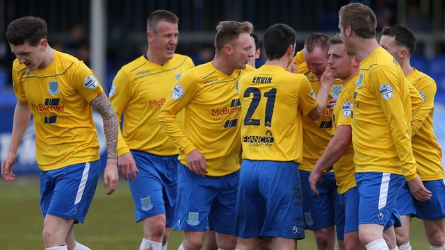 Ballymena United players celebrate victory over Dungannon Swifts at Stangmore Park