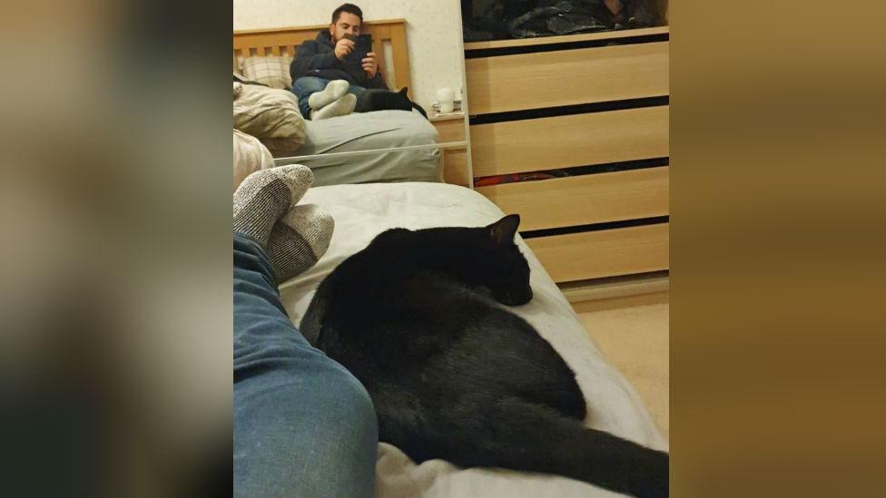 Jordan Harvey and cat