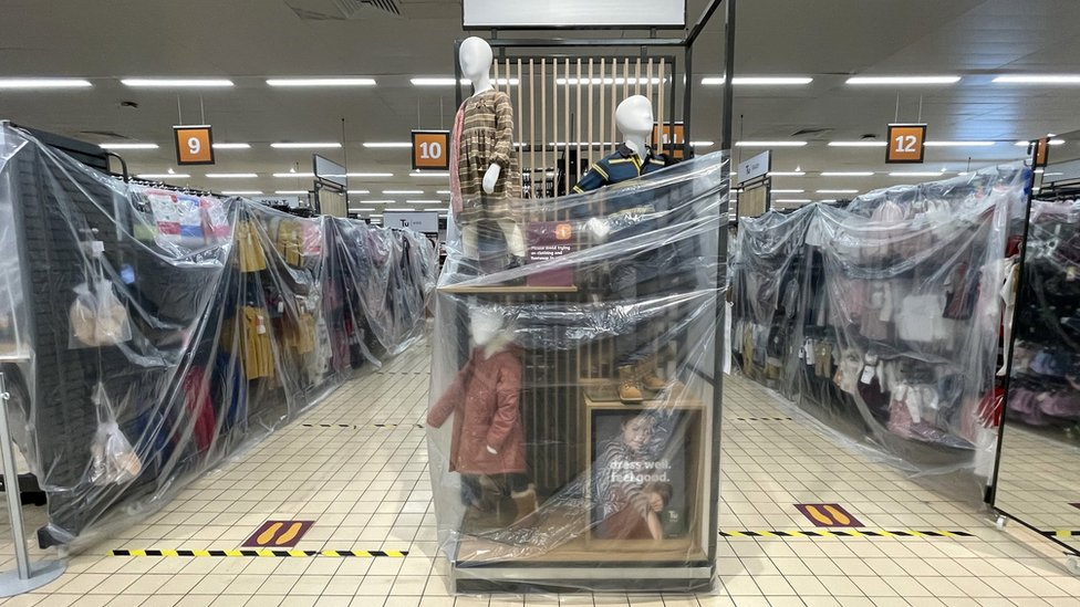 Clothes rails covered in cellophane in Sainsbury's in Cardiff