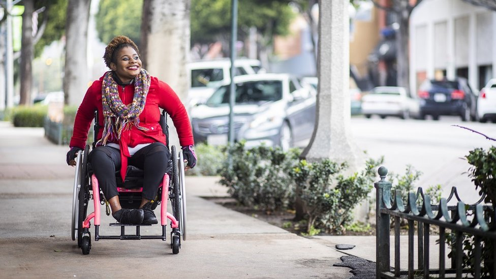 Young woman on a wheelchair out and bout