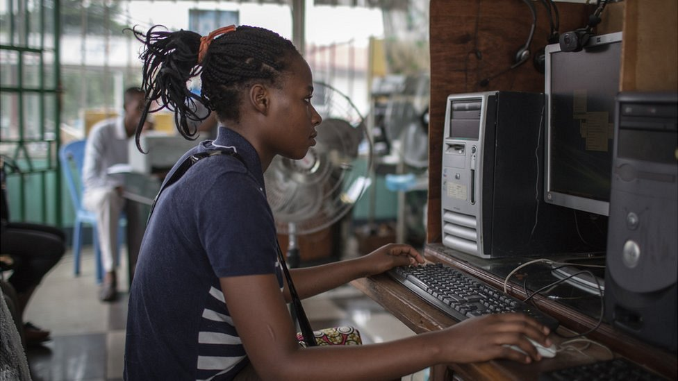 A girl in the Democratic of Congo on a computer