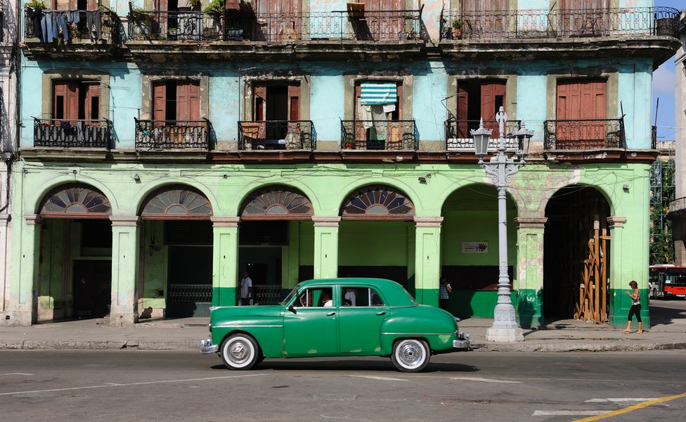 Brightly-painted buildings on Paseo de Marti opposite the National Capitol Building in Havana