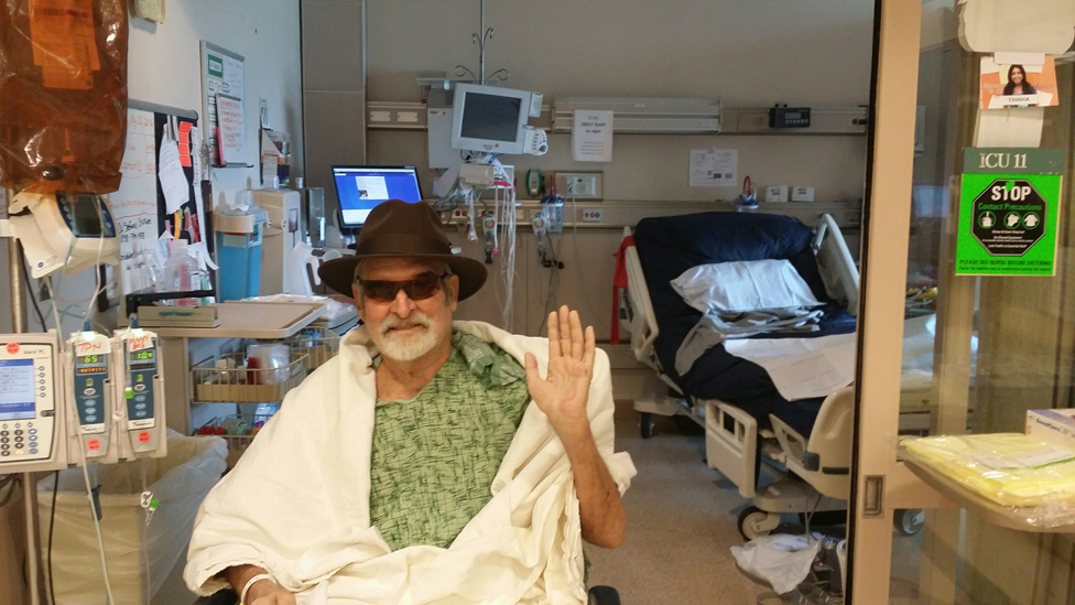 Tom saying goodbye to his hospital bed
