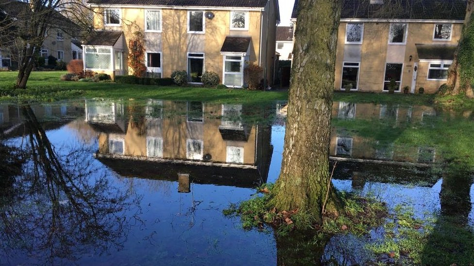 Flooding near homes in Abbey Grounds, Cirencester, caused by the River Churn