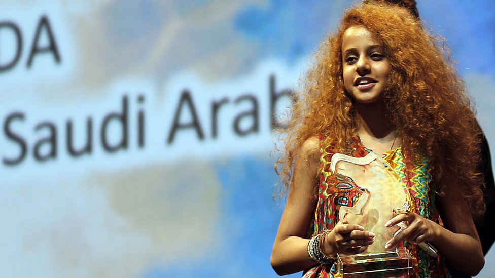 Saudi Actress Waad Mohammed accepts the Muhr Arab Feature award (Best Actress) for her film Wadjda