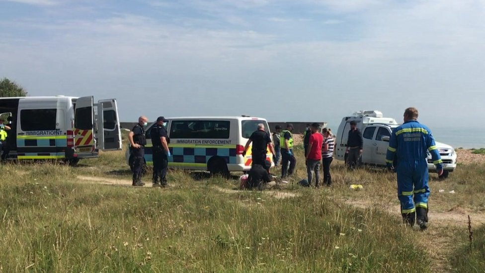 Migrants and Border Force officers in Kingsdown