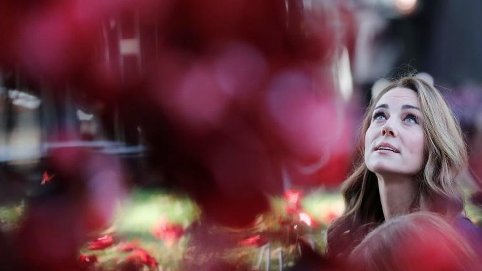 The Duchess of Cambridge, looks at the Weeping Window ceramic poppies installation as she arrives at the Imperial War Museum, in London, on October 31, 2018.
