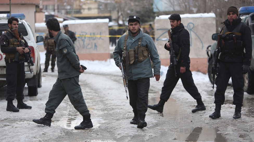 Police officers inspect the site of suicide attack at the Supreme Court in Kabul, Afghanistan on 7 February 2017