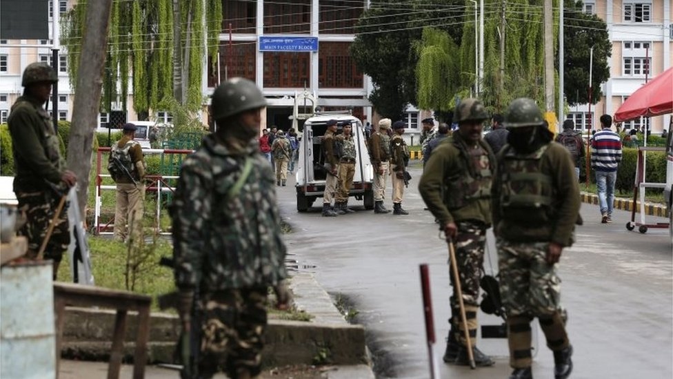 Indian paramilitary soldiers of Central Reserve Police Force (CRPF) stand guard near the main gate of the National Institute of Technology (NIT) in Srinagar,