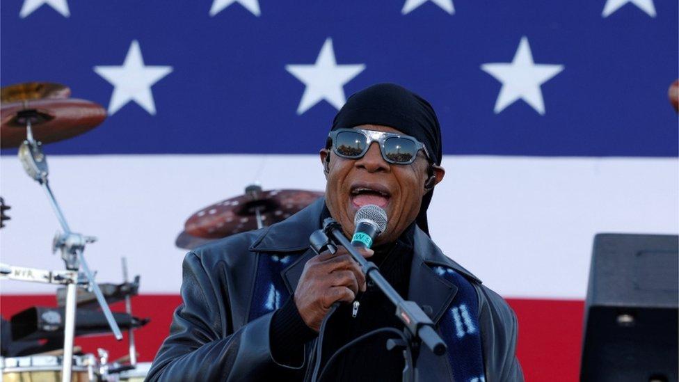 Stevie Wonder performing at an event for Joe Biden
