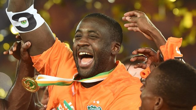 Manchester City midfielder Yaya Toure celebrates winning the Africa Cup of Nations with the Ivory Coast