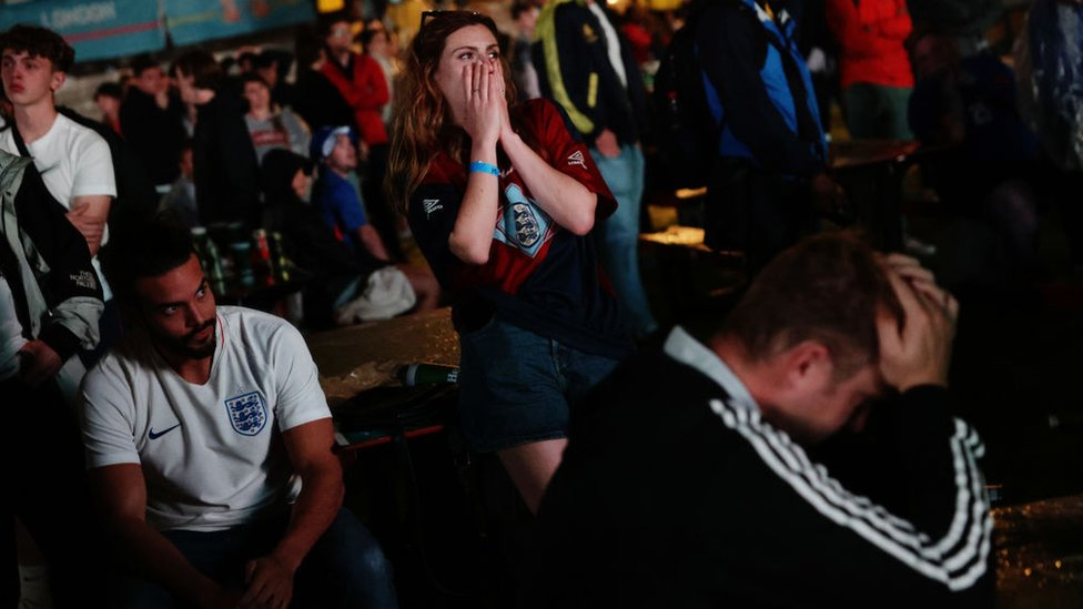 Fans look on in disbelief as England fail to make a penalty