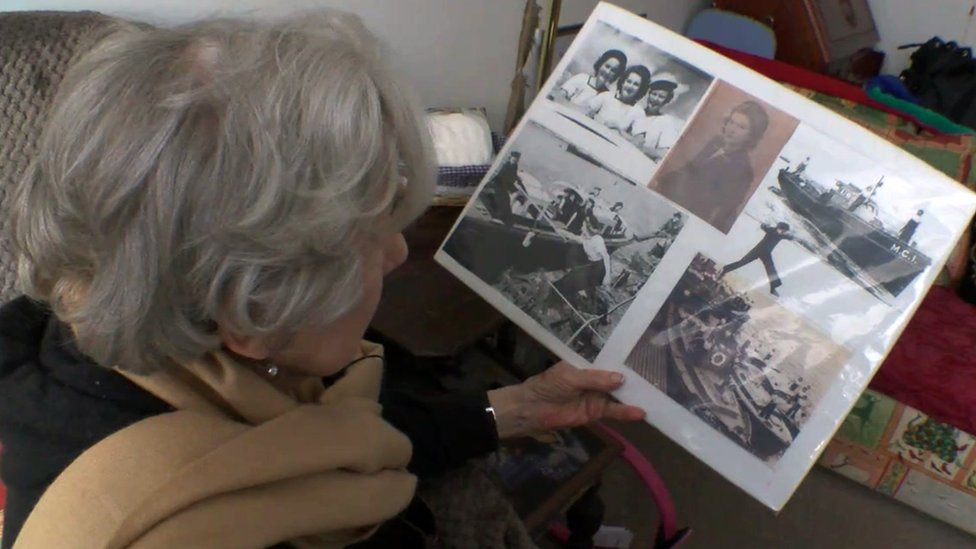 Mollie looking at some photographs of her wartime service