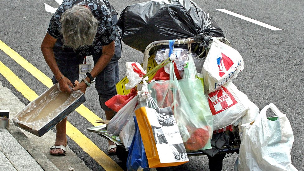 Woman cart waste collection Singapore