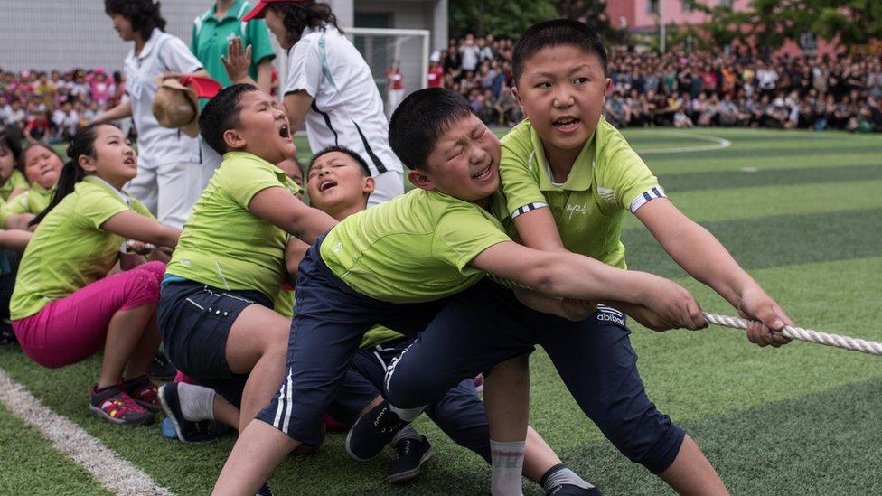 Schoolchildren playing tug-of-war in Pyongyang
