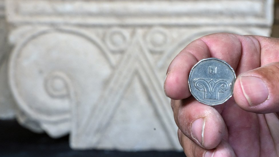 Five shekel coin against the background of the capital discovered