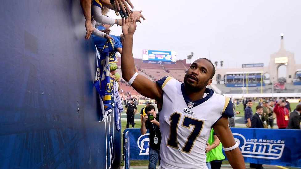 Robert Woods of the Los Angeles Rams celebrates a 33-7 win over the Houston Texans with fans at Los Angeles Memorial Coliseum