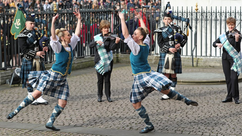Highland dancers and musicians performing outside Westminster Abbey ahead of the service