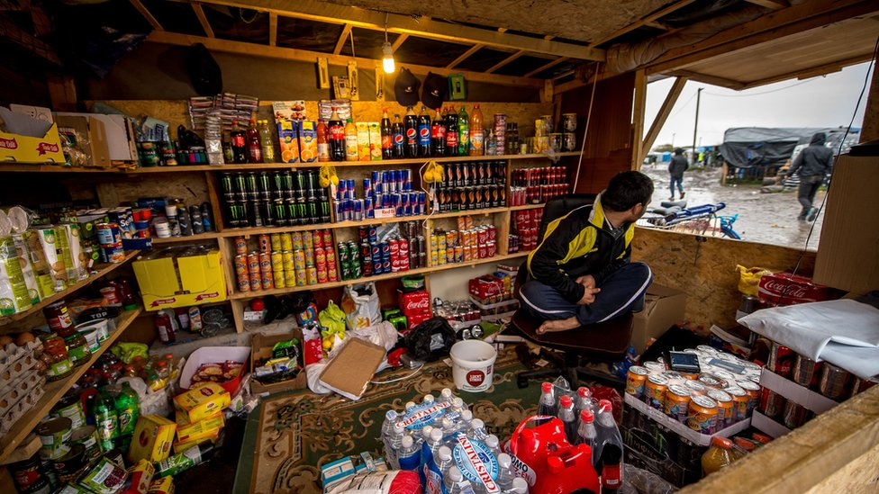Some migrants have set up shops, cafes and restaurants as they wait to make the journey on from Calais