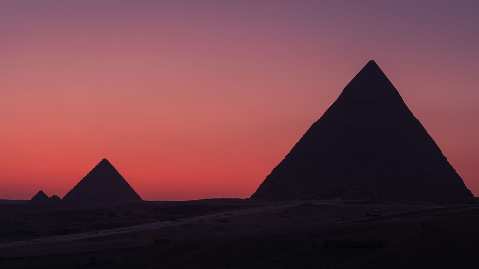 Red skies and the pyramids of Cairo, Egypt