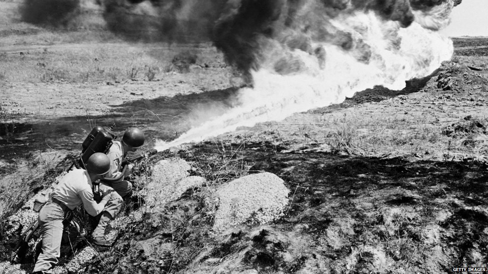 A picture dated circa April 15, 1951 shows marines from the US Allied Forces using a flame-thrower to clean the field during the Korean War.