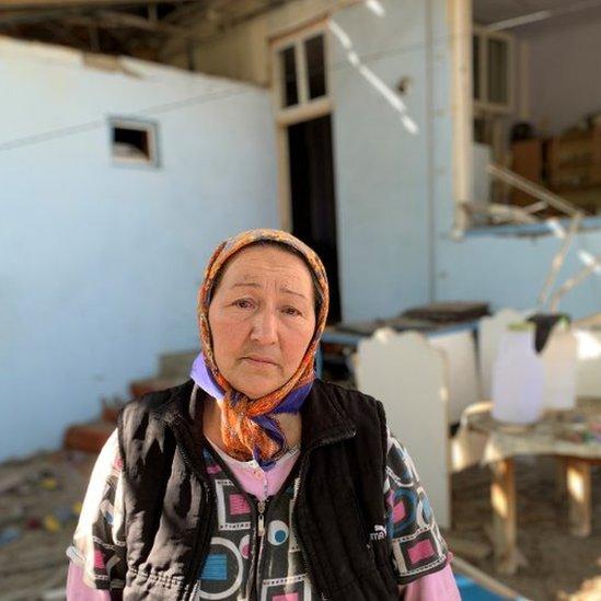 Nushabe in the debris of her home in Ganja