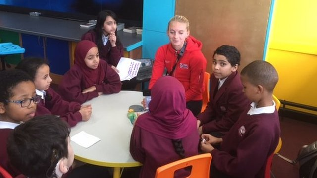 Hannah England with children at the Percy Shurmer Academy in Central Birmingham – she was there for Sport Relief
