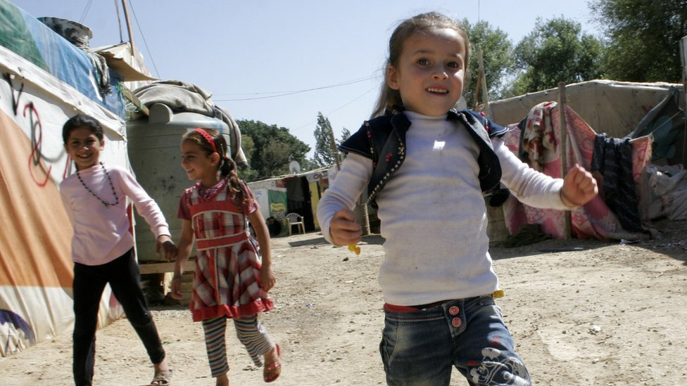 Children play at the Yaqteen refugee camp in Lebanon