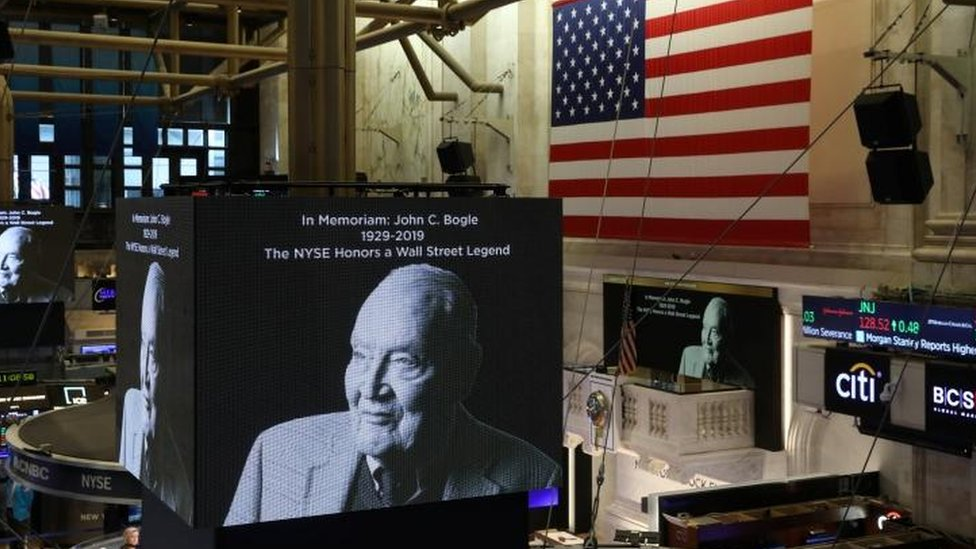 Screens display a tribute to Jack Bogle, founder and retired CEO of The Vanguard Group, on the floor of the New York Stock Exchange