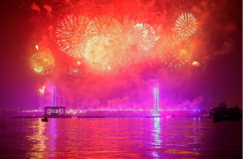 Fireworks explode into orange in the night sky over the Nile.