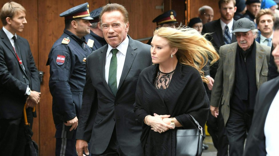 Austrian-US actor, filmmaker, politician and activist Arnold Schwarzenegger and his girlfriend Heather Milligan are pictured in Vienna