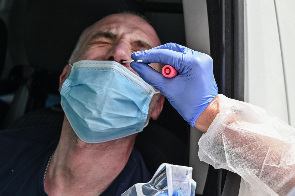A man is tested for coronavirus after losing the sense of taste and smell, at a drive-in testing centre in Villefranche sur Saone, France, on 22 April