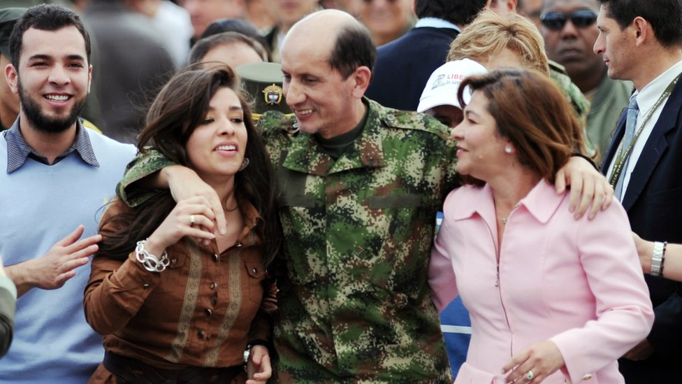 Former Revolutionary Armed Forces of Colombia (FARC) hostage Gen Luis Herlindo Mendieta (C) hugs his family upon arrival in Bogota on June 14, 2010.