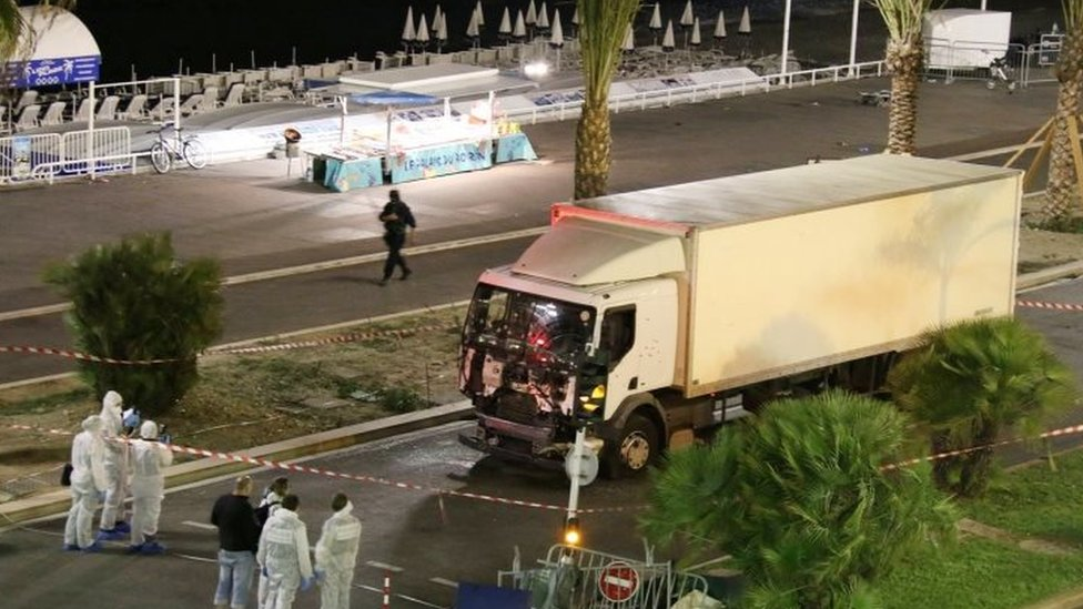 Authorities investigate a truck after it ploughed through Bastille Day revellers in the French resort city of Nice (15 July 2016)