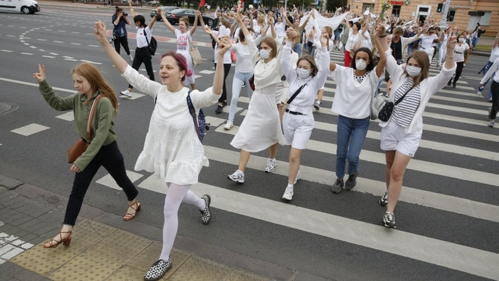 Women rally in support of detained and injured participants of the protests that erupted in the aftermath of the presidential election, in Minsk, Belarus, 12 August 2020