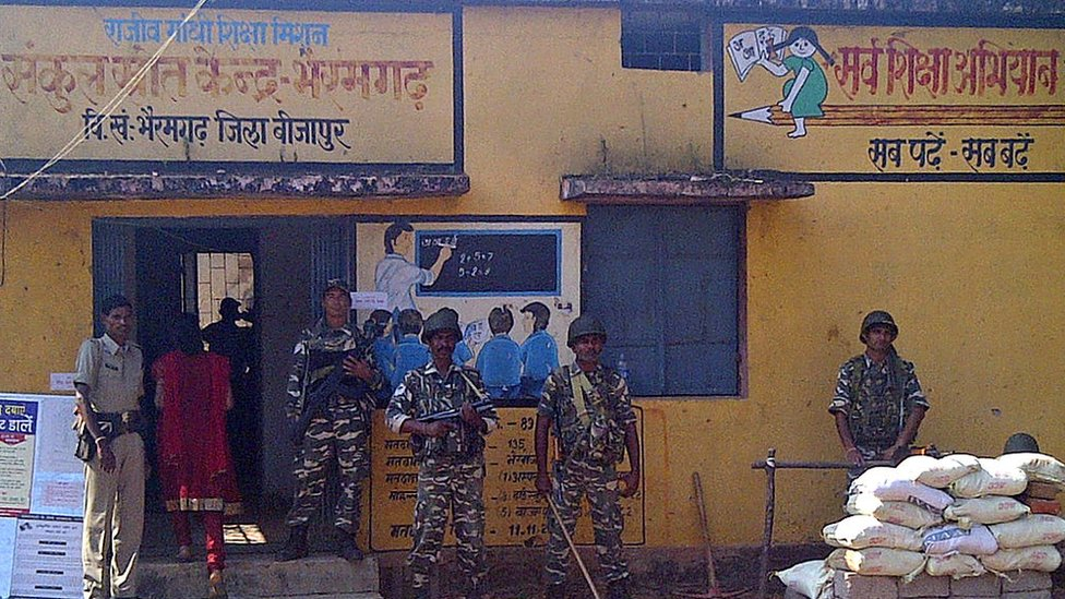 Indian security personnel keep watch at a polling station in Bhairamgarh, Bijapur district in the Bastar region of Chhattisgarh, on November 11, 2013.
