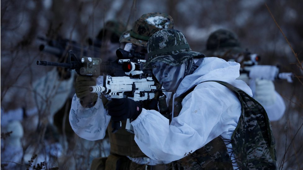 South Korean and US marines in winter camouflage participate in a winter military drill in Pyeongchang, South Korea, 24 January 2017.
