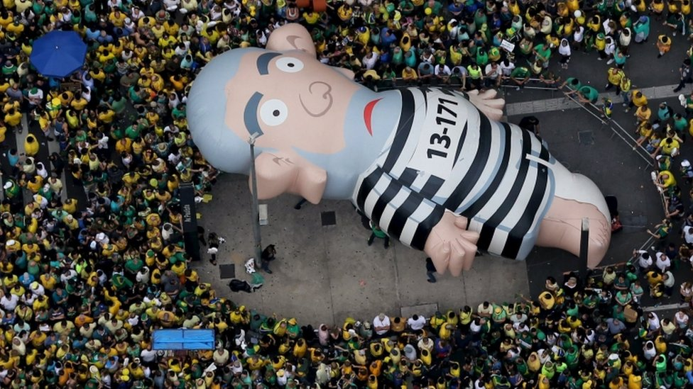 """An inflatable doll known as """"Pixuleco"""" of Brazil""""s former President Luiz Inacio Lula da Silva is seen during a protest against Rousseff, part of nationwide protests calling for her impeachment, in Sao Paulo"""