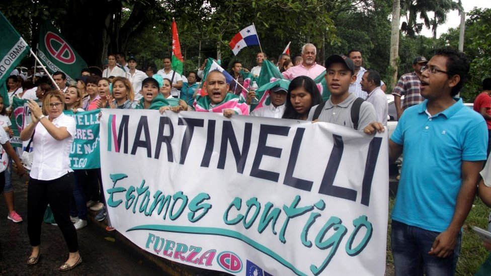 "Supporters of former Panama president Ricardo Martinelli hold a banner reading: ""Martinelli, we are with you"" during a protest outside the Supreme Court in Panama City, Panama June 11, 2018"
