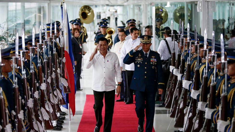 Philippine President Rodrigo Duterte reviews honour guards during a departure ceremony at the Manila International Airport, Philippines, 13 December 2016.