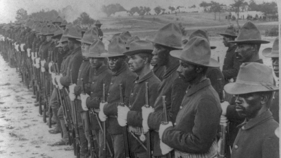Formation of black soldiers, after Spanish-American War, c. 1899