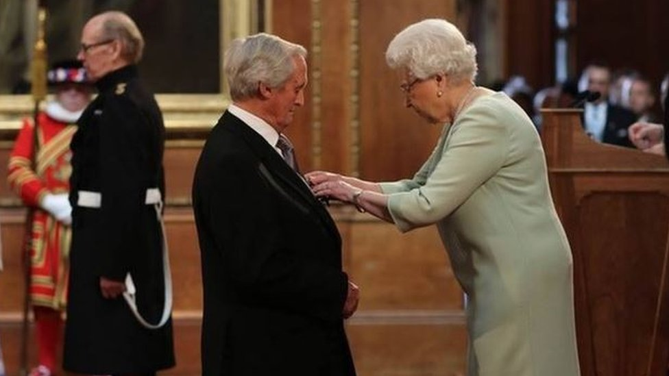 Bob Woodward being awarded the OBE by the Queen