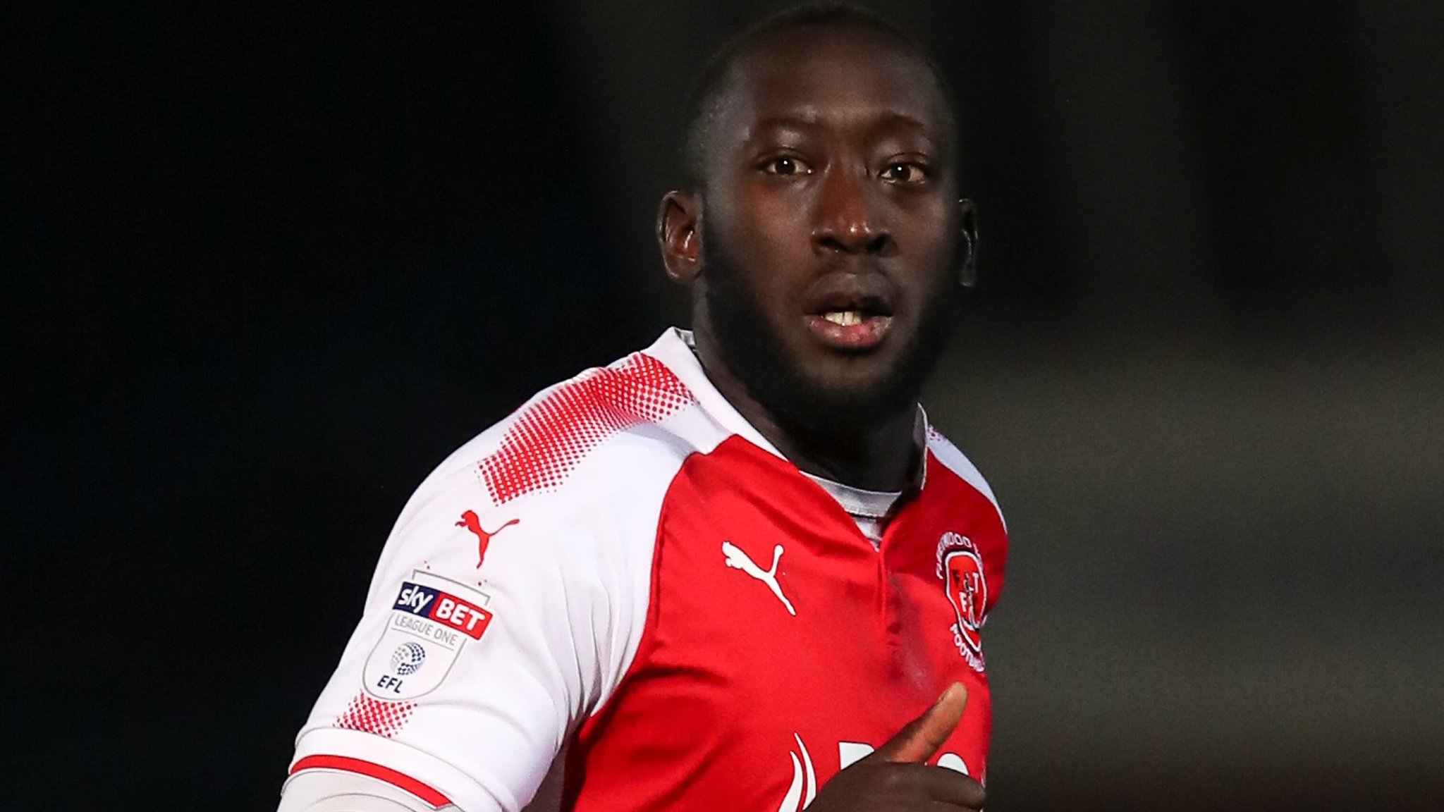 Toumani Diagouraga: Swindon Town sign Fleetwood Town midfielder