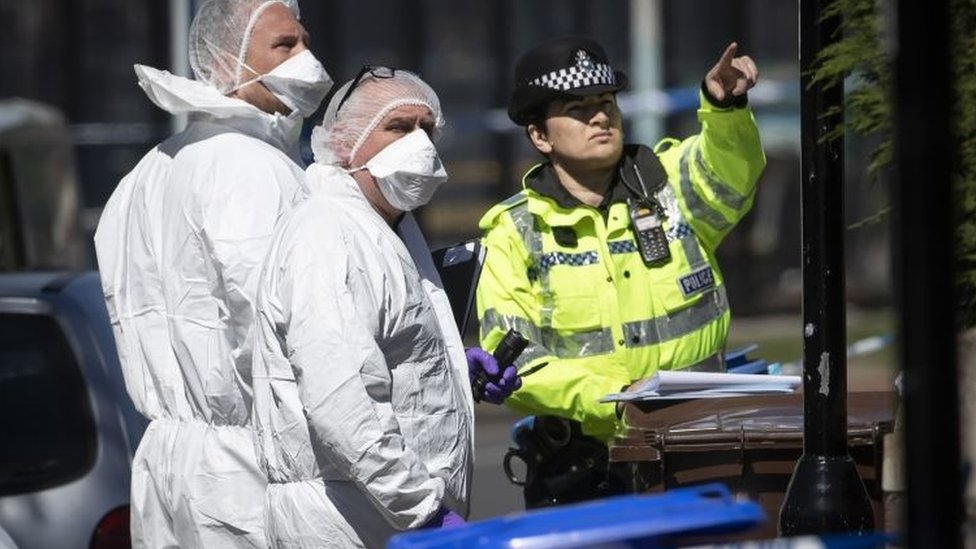 Police and forensic officers at the scene