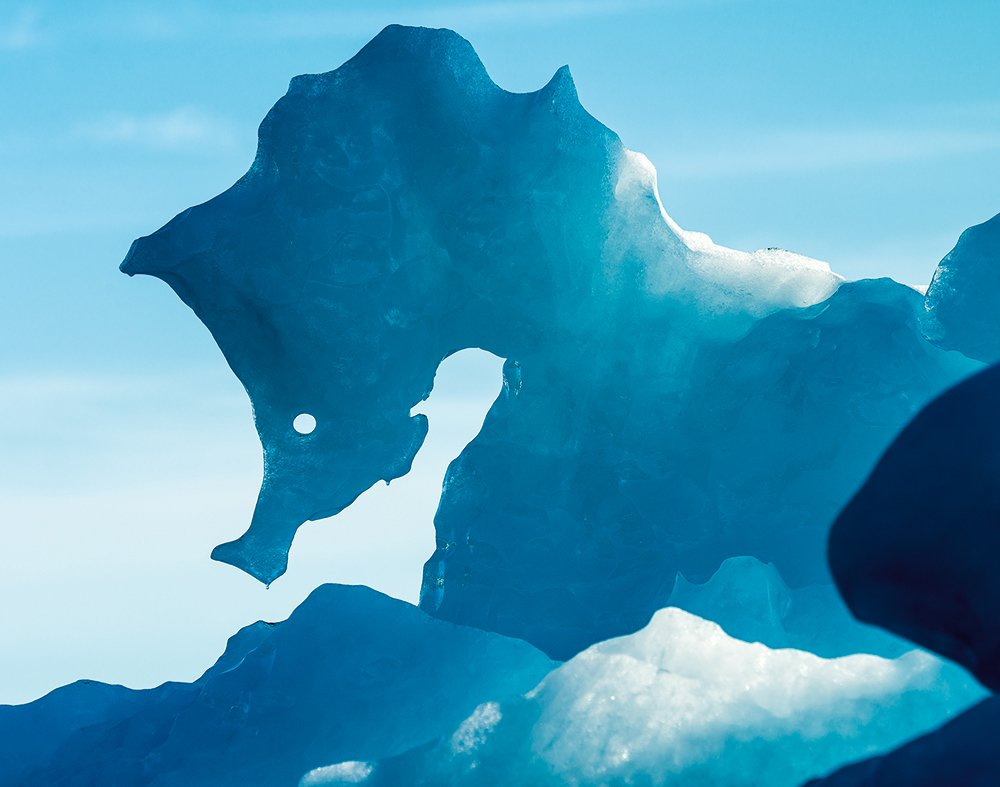 A view of iceberg that resembles the shape of a seahorse