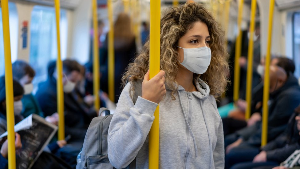 Passengers on a train in face masks